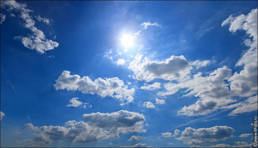 Фото неба с солнцем и облаками